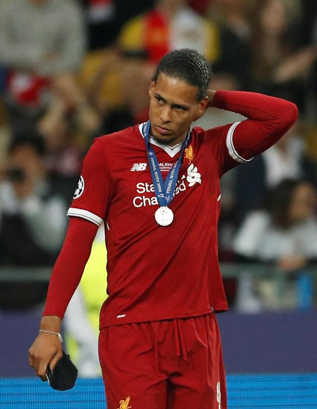 Soccer Football - Champions League Final - Real Madrid v Liverpool - NSC Olympic Stadium, Kiev, Ukraine - May 26, 2018 Liverpool's Virgil van Dijk looks dejected with his runners up medal after the match REUTERS/Andrew Boyers