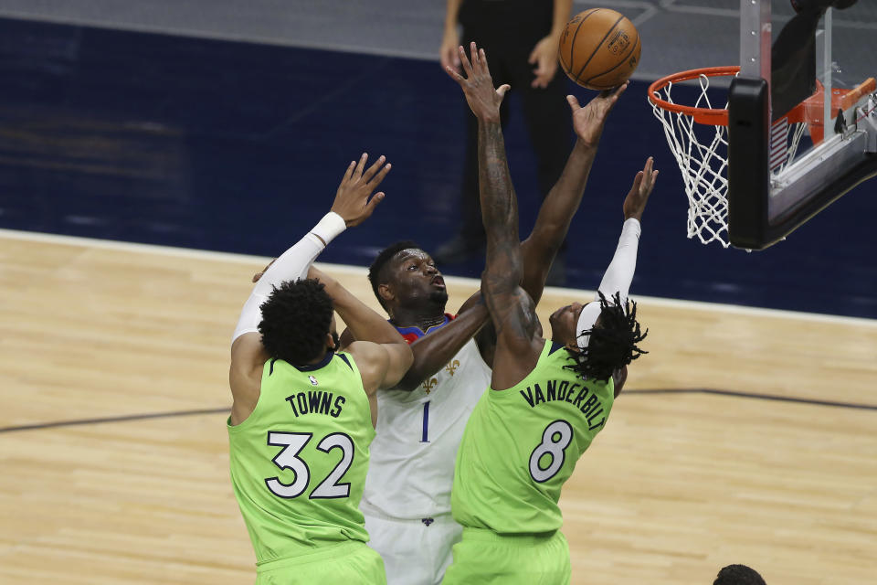 New Orleans Pelicans' Zion Williamson (1) shoots against Minnesota Timberwolves' Karl-Anthony Towns (32) and Jarred Vanderbilt (8) during the first half of an NBA basketball game Saturday, May 1, 2021, in Minneapolis. (AP Photo/Stacy Bengs)