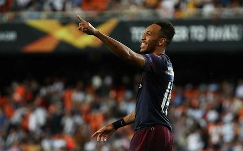 Arsenal's Pierre-Emerick Aubameyang celebrates scoring their fourth goal to complete his hat-trick - Credit: REUTERS