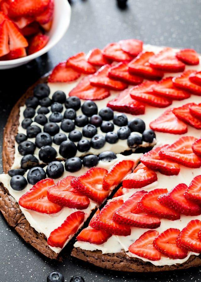 """<p>Instead of making ordinary brownies, create this flag-inspired dessert pizza! Your guests will love the creativity.</p><p><strong>Get the recipe at <a href=""""https://www.jocooks.com/recipes/red-white-and-blue-brownie-pizza/"""" rel=""""nofollow noopener"""" target=""""_blank"""" data-ylk=""""slk:Jo Cooks"""" class=""""link rapid-noclick-resp"""">Jo Cooks</a>. </strong></p><p><strong><a class=""""link rapid-noclick-resp"""" href=""""https://go.redirectingat.com?id=74968X1596630&url=https%3A%2F%2Fwww.walmart.com%2Fsearch%2F%3Fquery%3Dpizza%2Bpan&sref=https%3A%2F%2Fwww.thepioneerwoman.com%2Ffood-cooking%2Fmeals-menus%2Fg32109085%2Ffourth-of-july-desserts%2F"""" rel=""""nofollow noopener"""" target=""""_blank"""" data-ylk=""""slk:SHOP PIZZA PANS"""">SHOP PIZZA PANS</a><br></strong></p>"""