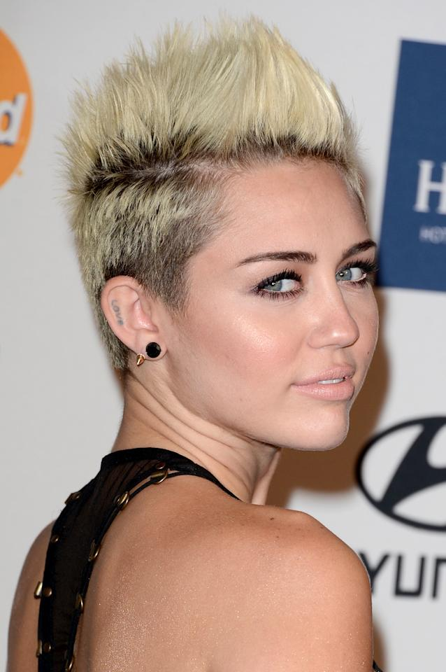 <b>Miley Cyrus</b> has been showing us the right ways to style short hair for months now, and this high-volume pixie cut is a fun way to add edge to your prom dress.