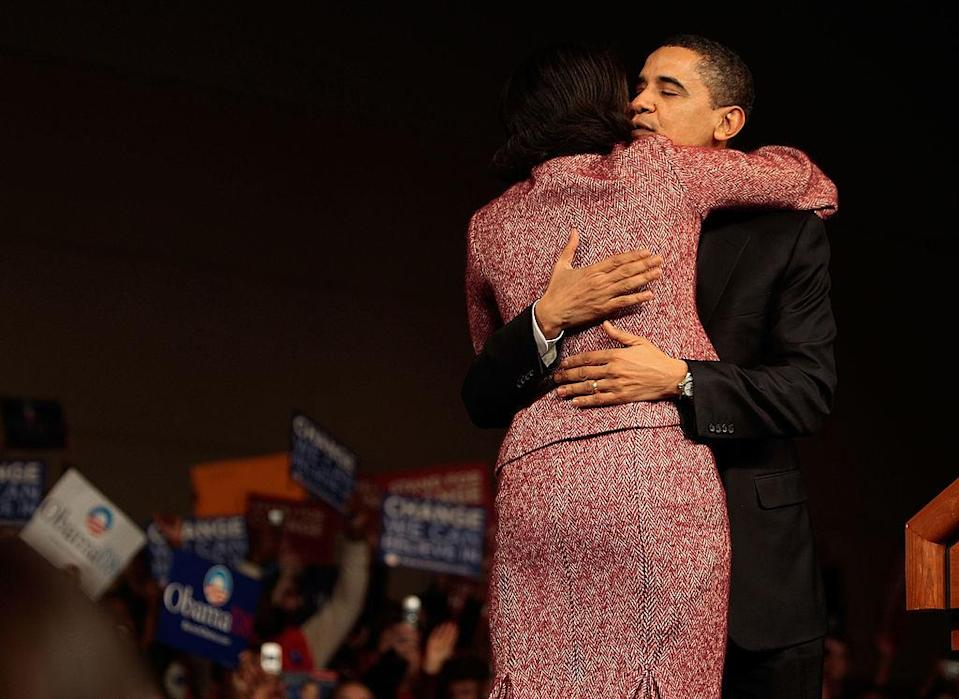 <p>A hug before taking the stage at a victory rally at the Columbia Metropolitan Convention Center [Photo: Chris Hondros/Getty] </p>