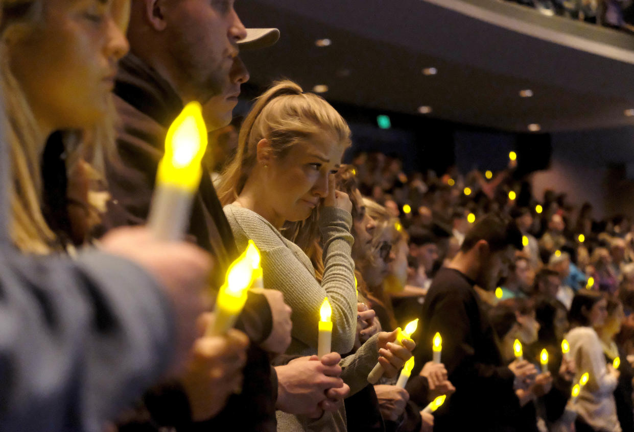 People gather to pray for the victims of a mass shooting at a candlelight vigil in Thousand Oaks, Calif., on Thursday. (Photo: Ringo H.W. Chiu/AP)