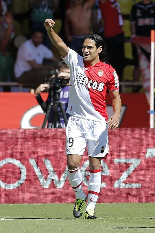 Monaco's Falcao of Colombia reacts after scoring the first goal against Lorient, during their French League One soccer match, in Monaco stadium, Sunday, Sept. 15, 2013. (AP Photo/Lionel Cironneau)