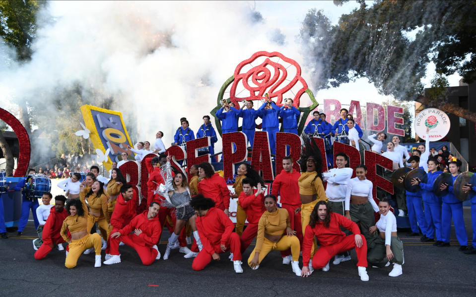 FILE - In this Wednesday, Jan. 1, 2020, file photo, singer Ally Brooke, middle in silver, performs at the 131st Rose Parade in Pasadena, Calif. Organizers have canceled the 2021 Rose Parade because of the impact of the coronavirus pandemic on long-range planning for the New Year's tradition. The Pasadena, California, Tournament of Roses Association said Wednesday, July 15, 2020, that the decision was put off until organizers were certain that safety restrictions would prevent the staging of the 132nd parade. (AP Photo/Michael Owen Baker, File)