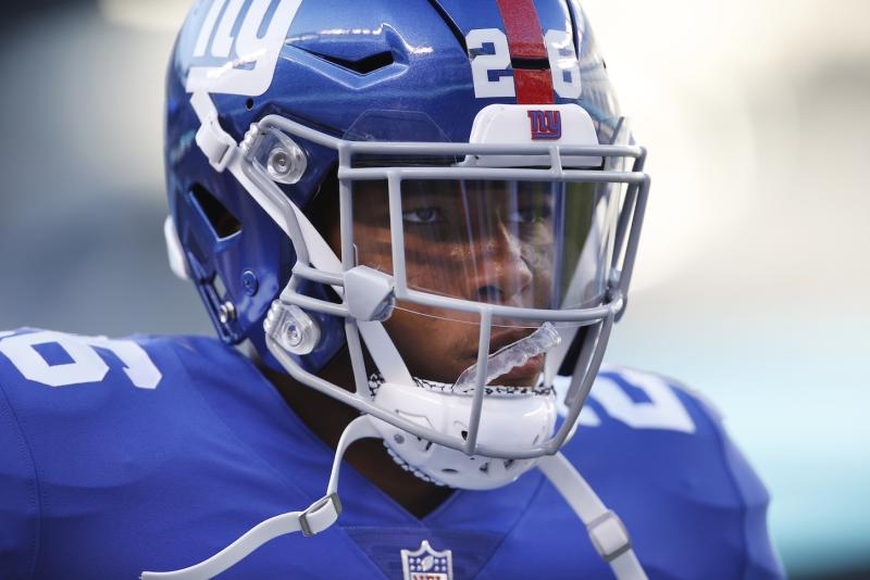 New York Giants running back Saquon Barkley scored a long touchdown run in his first NFL game. (AP)