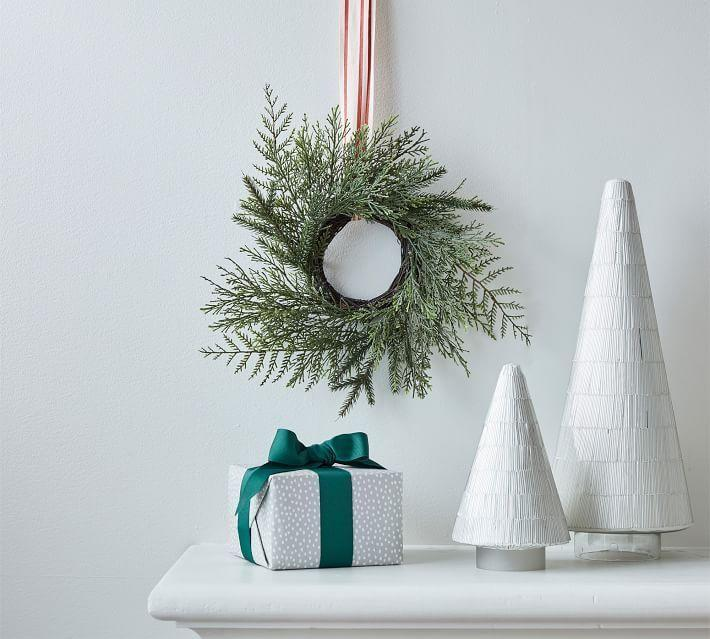 "<p>potterybarn.com</p><p><strong>$39.50</strong></p><p><a href=""https://go.redirectingat.com?id=74968X1596630&url=https%3A%2F%2Fwww.potterybarn.com%2Fproducts%2Ffaux-mixed-pine-wreath%2F&sref=https%3A%2F%2Fwww.housebeautiful.com%2Fshopping%2Fg34426352%2Fpottery-barn-christmas-collection-2020%2F"" rel=""nofollow noopener"" target=""_blank"" data-ylk=""slk:BUY NOW"" class=""link rapid-noclick-resp"">BUY NOW </a></p>"
