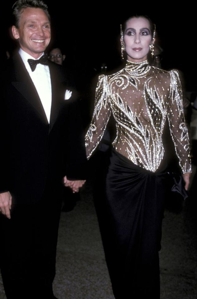 """<p>For the 1985 theme """"Costumes of India,"""" iconic costume pair <a href=""""https://www.crfashionbook.com/celebrity/a26896111/bob-mackie-cher-interview-broadway/"""" target=""""_blank"""">Bob Mackie</a> and <a href=""""https://www.crfashionbook.com/celebrity/g27153216/chers-secret-moments/"""" target=""""_blank"""">Cher</a> teamed up to create his sheer two-piece featuring rich fabric detail. </p>"""
