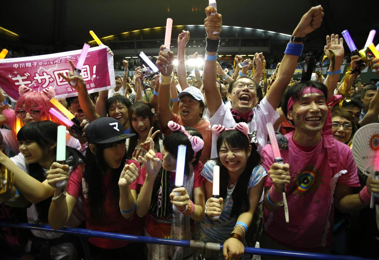 People celebrate after hearing that Tokyo had been chosen to host the 2020 Olympic Games during a public viewing event in Tokyo September 8, 2013. Tokyo was awarded the 2020 summer Olympic Games on Saturday following a vote by the International Olympic Committee. REUTERS/Toru Hanai (JAPAN - Tags: SPORT OLYMPICS)