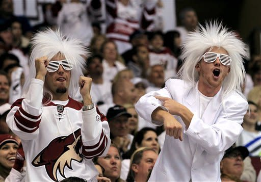 Phoenix Coyotes fans cheer on their team during the second period in Game 1 of an NHL hockey Stanley Cup first-round playoff series against the Chicago Blackhawks Thursday, April 12, 2012, in Glendale, Ariz. The Coyotes defeated the Blackhawks 3-2.(AP Photo/Ross D. Franklin)