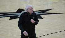 San Antonio Spurs head coach Gregg Popovich walks off the court after the team's loss against the Portland Trail Blazers in an NBA basketball game in San Antonio, Friday, April 16, 2021. (AP Photo/Eric Gay)