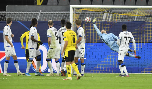 Brugge's goalkeeper Simon Mignolet unsuccessfully dives to save a goal by Dortmund's Jadon Sancho, unseen, during the Champions League group F soccer match between Borussia Dortmund and Club Brugge in Dortmund, Germany, Tuesday, Nov. 24, 2020. (AP Photo/Martin Meissner)