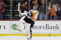 Philadelphia Flyers goaltender Carter Hart reacts after New Jersey Devils' Taylor Hall missed the last shot of a shootout in an NHL hockey game in Newark, N.J., Friday, Nov. 1, 2019. The Flyers won 4-3. (AP Photo/Seth Wenig)