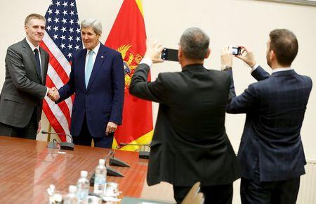 U.S. Secretary of State John Kerry (2nd L) meets Montenegro's Foreign Minister Igor Luksic (L) at the NATO ministerial meetings at NATO Headquarters in Brussels December 2, 2015. REUTERS/Jonathan Ernst