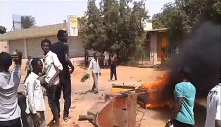 Demonstrators gather at Kalakla Market during a protest against a cut in fuel subsidies in south Khartoum