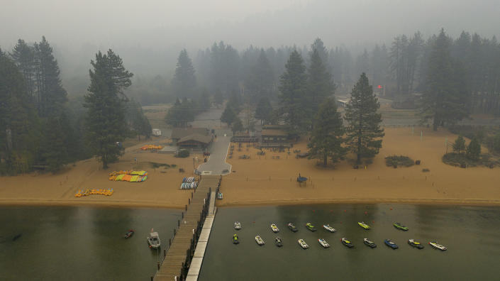 Smoke from the Caldor Fire fills the sky above Lake Tahoe's Zephyr Cove in Douglas County, Nev., on Friday, Aug. 27, 2021. (AP Photo/Noah Berger)