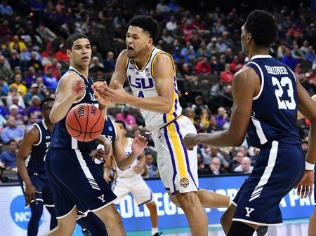 Mar 21, 2019; Jacksonville, FL, USA; LSU Tigers guard Skylar Mays (4) loses the ball against Yale Bulldogs forward Paul Atkinson (left) and forward Jordan Bruner (23) during the second half in the first round of the 2019 NCAA Tournament at Jacksonville Veterans Memorial Arena. Mandatory Credit: John David Mercer-USA TODAY Sports