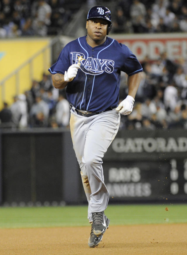 Tampa Bay Rays' Delmon Young rounds the bases on a home run during the seventh inning of a baseball game against the New York Yankees on Thursday, Sept. 26, 2013, at Yankee Stadium in New York. (AP Photo/Bill Kostroun)