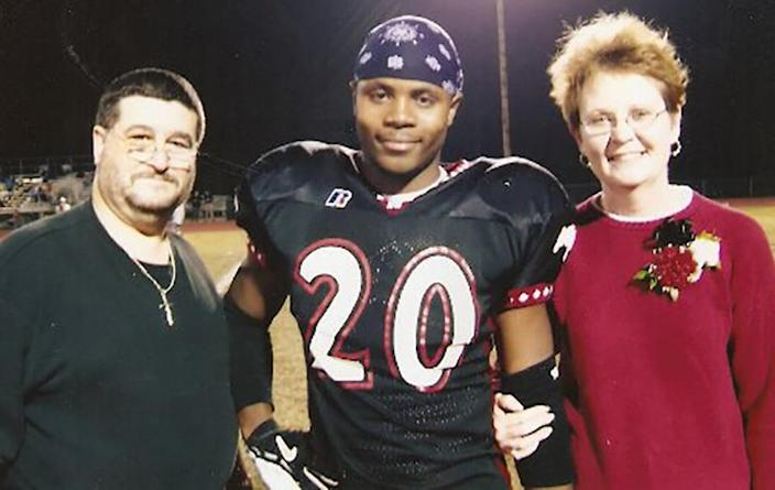 Darrion Cockrell with Dennis Kaeser, his middle school football coach, and Kaeser's wife. The couple eventually became his foster parents. (Courtesy Darrion Cockrell)