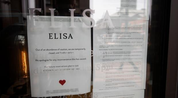 A letter posted on the door of Elisa steak house from Vancouver Coastal Health outlines the reasons the restaurant was issued a closure notice.