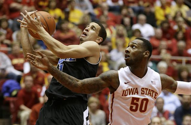 Missouri-Kansas City forward Nelson Kirksey, left, grabs a rebound over Iowa State guard DeAndre Kane during the first half of an NCAA college basketball game, Monday, Nov. 25, 2013, in Ames, Iowa. (AP Photo/Charlie Neibergall)