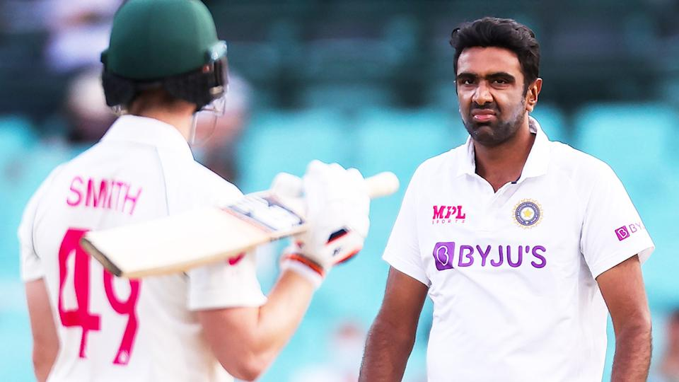 Ravichandran Ashwin (pictured right) reacts after a delivery to Steven Smith (pictured left).