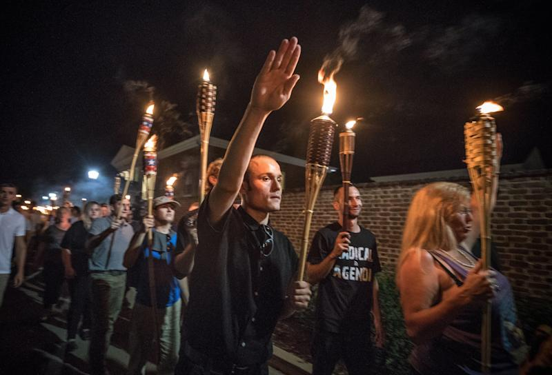 "Chanting, ""White lives matter! You will not replace us!"" and ""Jews will not replace us!"" white nationalists and white supremacists march through the University of Virginia campus on Aug. 11, 2017. (Photo: Evelyn Hockstein for the Washington Post via Getty Images)"