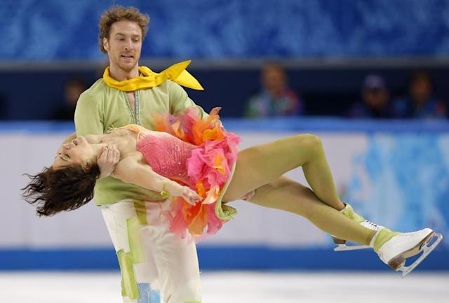 Nathalie Pechalat and Fabian Bourzat of France compete in the ice dance free dance figure skating finals at the Iceberg Skating Palace during the 2014 Winter Olympics, Monday, Feb. 17, 2014, in Sochi, Russia. (AP Photo/Vadim Ghirda)