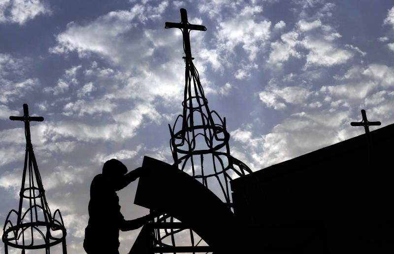 In this Thursday, Aug. 30, 2012 photo, a man works on a construction project at Sacred Heart Church in Manama, Bahrain. When Bahrain announced plans to build the largest Roman Catholic Church in the Gulf, it was accompanied by a noticeable dose of pride to showcase its traditions of religious tolerance. Instead, the planned church has turned into another point of tension in a country already being pulled apart by internal sectarian battles. (AP Photo/Hasan Jamali)