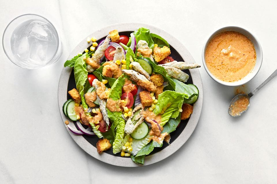 """If fresh corn and okra elude you on Thanksgiving, this twist on a classic (with its spicy, creamy dressing, and <a href=""""https://www.epicurious.com/expert-advice/is-it-crispy-or-is-it-crunchy-article?mbid=synd_yahoo_rss"""" rel=""""nofollow noopener"""" target=""""_blank"""" data-ylk=""""slk:crunchy"""" class=""""link rapid-noclick-resp"""">crunchy</a> corn bread croutons) would still be a welcome holiday table addition. <a href=""""https://www.epicurious.com/recipes/food/views/creole-caesar-salad-with-corn-bread-croutons?mbid=synd_yahoo_rss"""" rel=""""nofollow noopener"""" target=""""_blank"""" data-ylk=""""slk:See recipe."""" class=""""link rapid-noclick-resp"""">See recipe.</a>"""