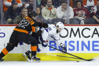 Philadelphia Flyers' Nicolas Aube-Kubel (62) and Tampa Bay Lightning's Nikita Kucherov (86) battle for the puck during the first period of an NHL hockey game, Saturday, Jan. 11, 2020, in Philadelphia. (AP Photo/Matt Slocum)