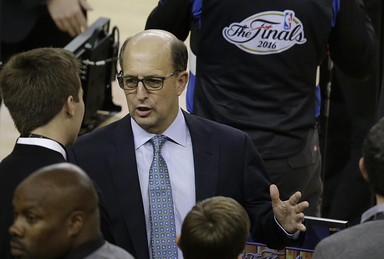 FILE - In this June 2, 2016, file photo, television announcer Jeff Van Gundy speaks before Game 1 of basketball's NBA Finals between the Golden State Warriors and the Cleveland Cavaliers, in Oakland, Calif. Former NBA coach Jeff Van Gundy will lead the U.S. men's basketball team through the early stages of qualifying for the 2019 Basketball World Cup. He will guide a team made up of mostly NBA G League players in this summer's FIBA AmeriCup 2017 tournament and in qualifying games between November and September 2018. USA Basketball announced Van Gundy's appointment Wednesday, July 5, 2017. (AP Photo/Ben Margot, File)