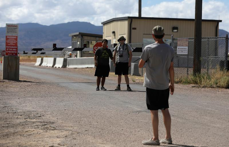 People take photos at the entrance to Area 51 as an influx of tourists responding to a call to 'storm' Area 51, a secretive U.S. military base believed by UFO enthusiasts to hold government secrets about extra-terrestrials, is expected in Rachel, Nevada,Sept. 19, 2019. (Photo: Jim Urquhart/Reuters)