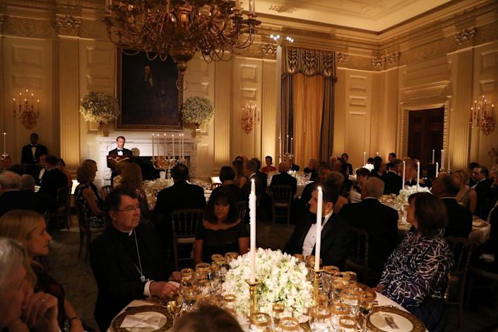 <p>During speeches, the lights were dimmed to put focus on the presenters. Thanks to the tall white candlesticks, this created a romantic vibe.</p>