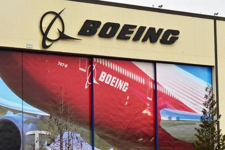 FILE PHOTO: Boeing Co's logo is seen above the front doors of its largest jetliner factory in Everett