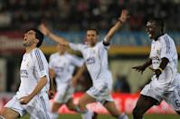 Reyes (L), Ivan Helguera (C) and Mali Mahamadou Diarra celebrate after scoring against Mallorca (JAIME REINA/AFP/Getty Images)