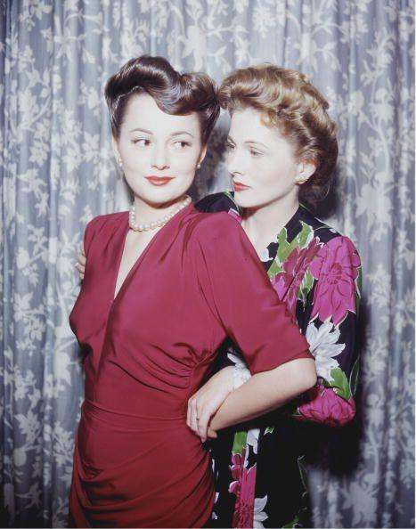 <p>Hollywood was a family affair for Olivia. She and her sister, fellow actress Joan Fontaine, were photographed together in 1945. </p>