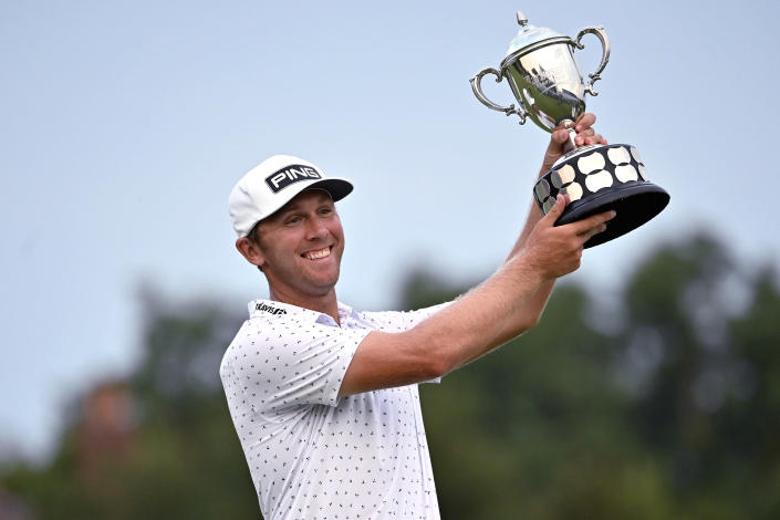 Seamus Power holds up the trophy following his victory in the Barbasol Championship golf tournament at Keene Trace in Nicholasville, Ky., Sunday, July 18, 2021. Power's victory over J.T. Poston came after six playoff holes. (AP Photo/Timothy D. Easley)