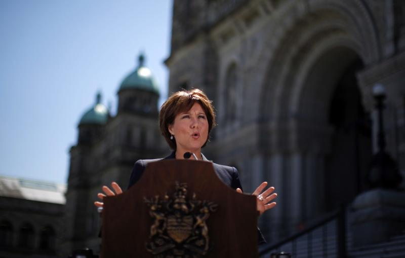 British Columbia Premier Christy Clark speaks to media outside the British Columbia legislature in Victoria, Tuesday, July 2, 2013, after two Canadian-born citizens were arrested in what police described as al-Qaida-inspired plot to blow up the legislature on Canada Day. (AP Photo/The Canadian Press, Chad Hipolito)