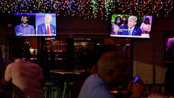 PHOTO: The dual town halls of Democratic presidential candidate Joe Biden and President Donald Trump are seen on television monitors at Luv Child restaurant ahead of the election in Tampa, Fla., Oct. 15, 2020. (Octavio Jones/Reuters)