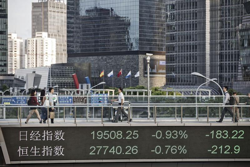 Stocks Trade at Highest in Decade; Oil Holds Gain: Markets Wrap