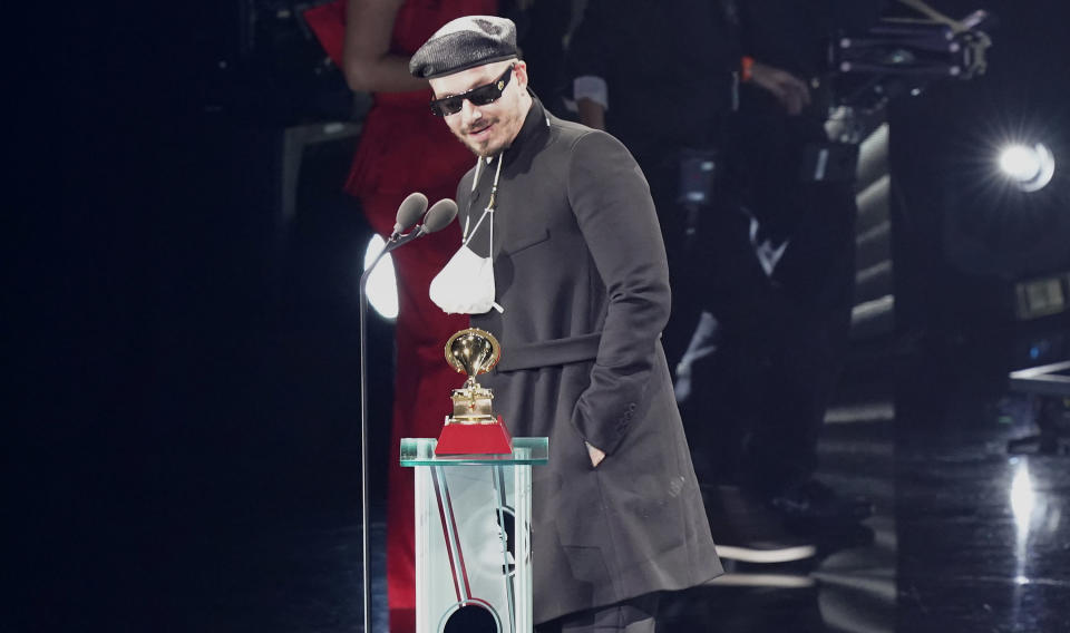 "J Balvin accepts the award for best urban music album for ""Colores"" at the 21st Latin Grammy Awards, airing on Thursday, Nov. 19, 2020, at American Airlines Arena in Miami. (AP Photo/Marta Lavandier)"