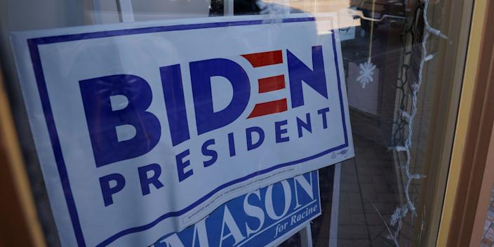 A sign supporting Democratic presidential nominee Joe Biden hangs in the window of the Racine County Democratic Party office, during the largely virtual Democratic National Convention (DNC), in Racine, Wisconsin, U.S., August 19, 2020.