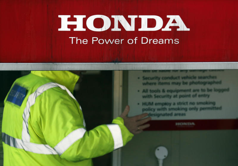 Security guards the entrance of the Honda car plant in Swindon, western England, Tuesday, Feb. 19, 2019. The Japanese carmaker Honda announced Tuesday that its car plant in Swindon will close with the potential loss of some 3,500 jobs.(AP Photo/Frank Augstein)