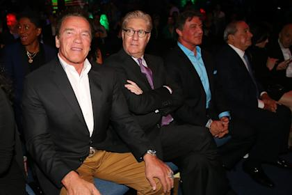 Arnold Schwarzenegger (L) and Sylvester Stallone (center right) look on during Manny Pacquiao's win. (Getty)