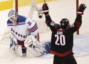 New York Rangers goaltender Henrik Lundqvist (30) reacts as Carolina Hurricanes center Sebastian Aho (20) celebrates his team's goal during the first period of an NHL Stanley Cup playoff hockey game in Toronto, Monday, Aug. 3, 2020. (Frank Gunn/The Canadian Press via AP)