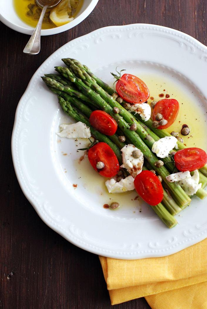 """<p>These fresh vegetables are full of flavor. Sauteed lightly in olive oil and garlic then served with homemade herb butter, they're the perfect addition to any meal.<br></p><p><a href=""""https://www.womansday.com/food-recipes/food-drinks/recipes/a39883/asparagus-peas-tomatoes-herb-butter-recipe-clx0414/"""" rel=""""nofollow noopener"""" target=""""_blank"""" data-ylk=""""slk:Get the recipe for Asparagus, Peas and Tomatoes."""" class=""""link rapid-noclick-resp""""><u><em>Get the recipe for Asparagus, Peas and Tomatoes.</em></u></a></p>"""