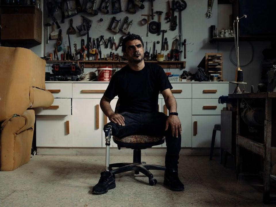 Mohammed Zidane, 40, sitting in his carpentry and upholstery workshop in Jebaliya Camp, Gaza, lost his leg during the fierce fighting of Gaza's first war, which started in 2008 (Paddy Dowling)