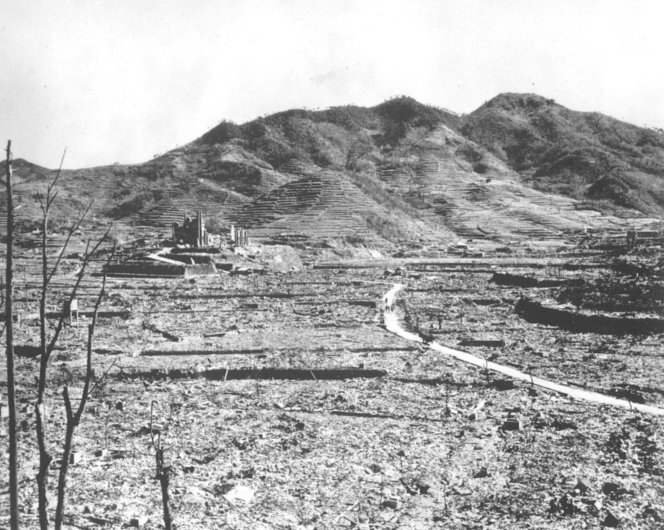 FILE - In this 1945, file photo, destroyed beyond recognition, the Roman Catholic Church of Urakami stands out over the burn-razed cityscape of Nagasaki, Japan, after the second atomic bomb ever used in warfare was dropped by the U.S. over the Japanese industrial center. The city of Nagasaki in southern Japan marks the 75th anniversary of the U.S. atomic bombing of Aug. 9, 1945. Japan surrendered on Aug. 15, ending World War II and its nearly a half-century aggression toward Asian neighbors.Dwindling survivors, whose average age exceeds 83, increasingly worry about passing their lessons on to younger generations. (AP Photo, File)