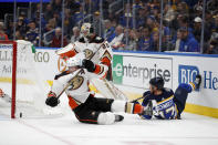 Anaheim Ducks' Cam Fowler (4) falls after colliding with St. Louis Blues' Jaden Schwartz (17) while chasing after a loose puck as Ducks goaltender John Gibson (36) watches during the second period of an NHL hockey game Monday, Jan. 13, 2020, in St. Louis. (AP Photo/Jeff Roberson)